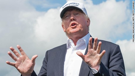 "Presumptive Republican presidential nominee Donald Trump speaks to members of the media during a tour of his International Golf Links course north of Aberdeen on the east coast of Scotland on June 25, 2016.  Donald Trump hailed Britain's vote to leave the EU as ""fantastic"" shortly after arriving in Scotland on Friday for his first international trip since becoming the presumptive Republican presidential nominee. / AFP / Michal Wachucik        (Photo credit should read MICHAL WACHUCIK/AFP/Getty Images)"
