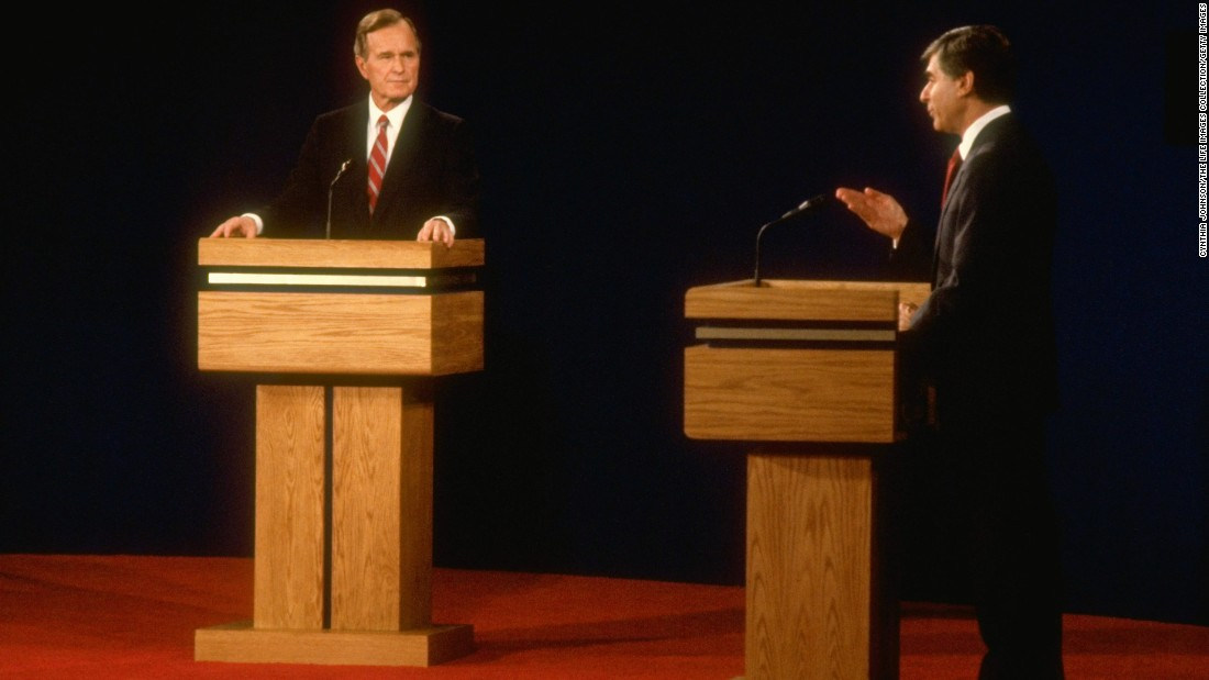 Democratic presidential candidate Michael Dukakis faces off against Bush during their first presidential debate in 1988.