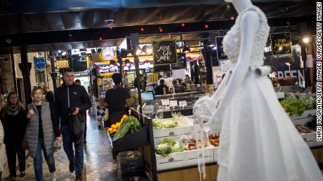TEL AVIV, ISRAEL - JANUARY 15: people are seen shopping in the upscale Sarona Market on January 15, 2017 in Tel Aviv, Israel. 70 countries attended the recent Paris Peace Summit and called on Israel and Palestinians to resume negotiations that would lead to a two-state solution, however the recent proposal by U.S President-elect Donald Trump to move the US embassy from Tel Aviv to Jerusalem and last month's U.N. Security Council resolution condemning Jewish settlement activity in the West Bank have contributed to continued uncertainty across the region. The ancient city of Jerusalem where Jews, Christians and Muslims have lived side by side for thousands of years and is home to the Al Aqsa Mosque compound or for Jews The Temple Mount, continues to be a focus as both Israelis and Palestinians claim the city as their capital. The Israeli-Palestinian conflict has continued since 1947 when Resolution 181 was passed by the United Nations, dividing Palestinian territories into Jewish and Arab states. The Israeli settlement program has continued to cause tension as new settlements continue to encroach on land within the Palestinian territories. The remaining Palestinian territory is made up of the West Bank and the Gaza strip. (Photo by Chris McGrath/Getty Images)