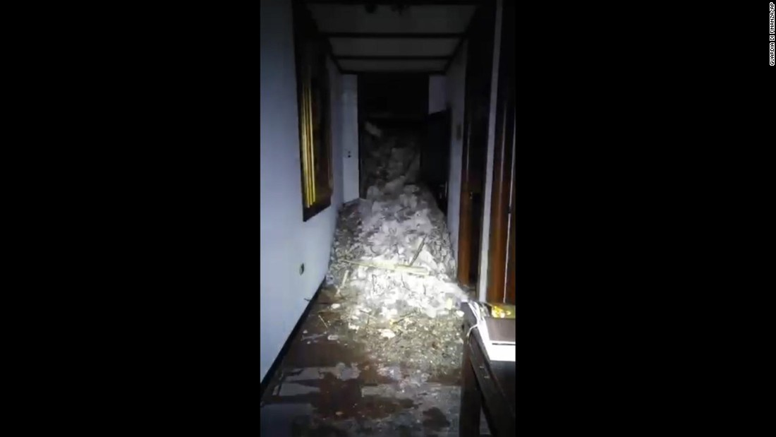 Snow and rubble fill a hallway inside Hotel Rigopiano. The area is a popular ski destination for Italian tourists.