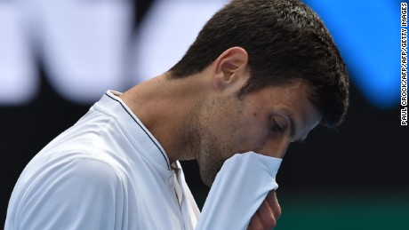 Serbia's Novak Djokovic reacts after a point against Uzbekistan's Denis Istomin during their men's singles match on day four of the Australian Open tennis tournament in Melbourne on January 19, 2017. / AFP / PAUL CROCK / IMAGE RESTRICTED TO EDITORIAL USE - STRICTLY NO COMMERCIAL USE        (Photo credit should read PAUL CROCK/AFP/Getty Images)