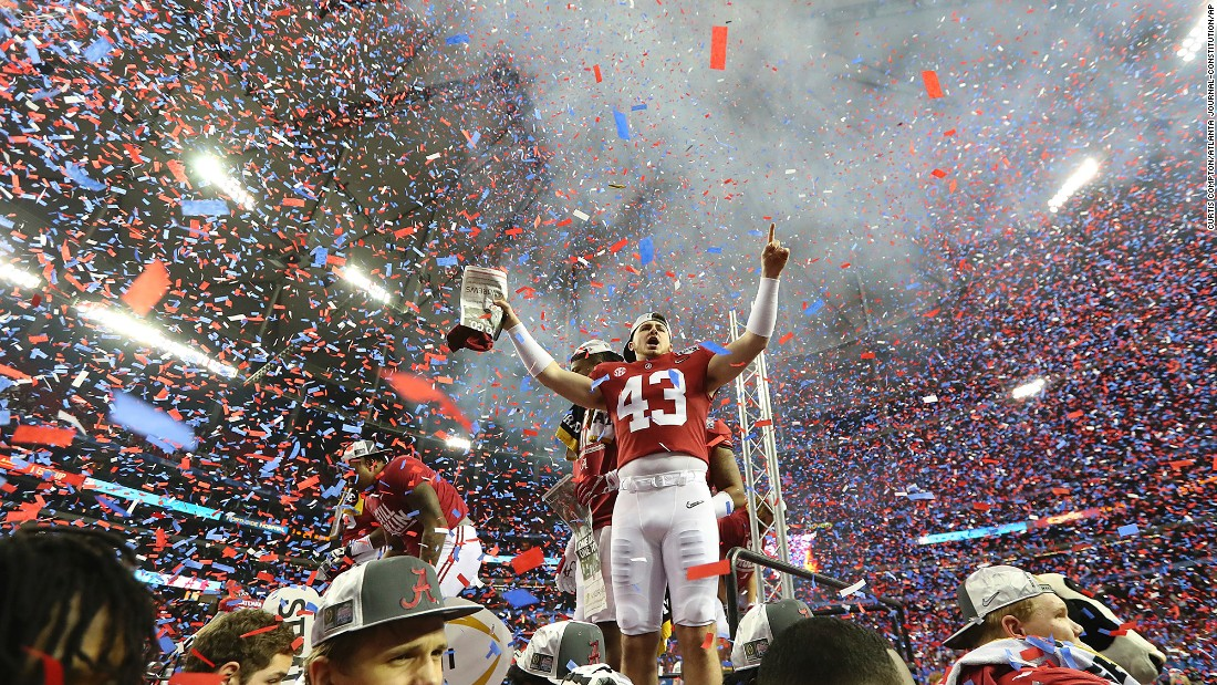 Confetti fills the Georgia Dome as Alabama celebrates a 24-7 victory over Washington in the College Football Playoff Peach Bowl semifinal on December 31, 2016.