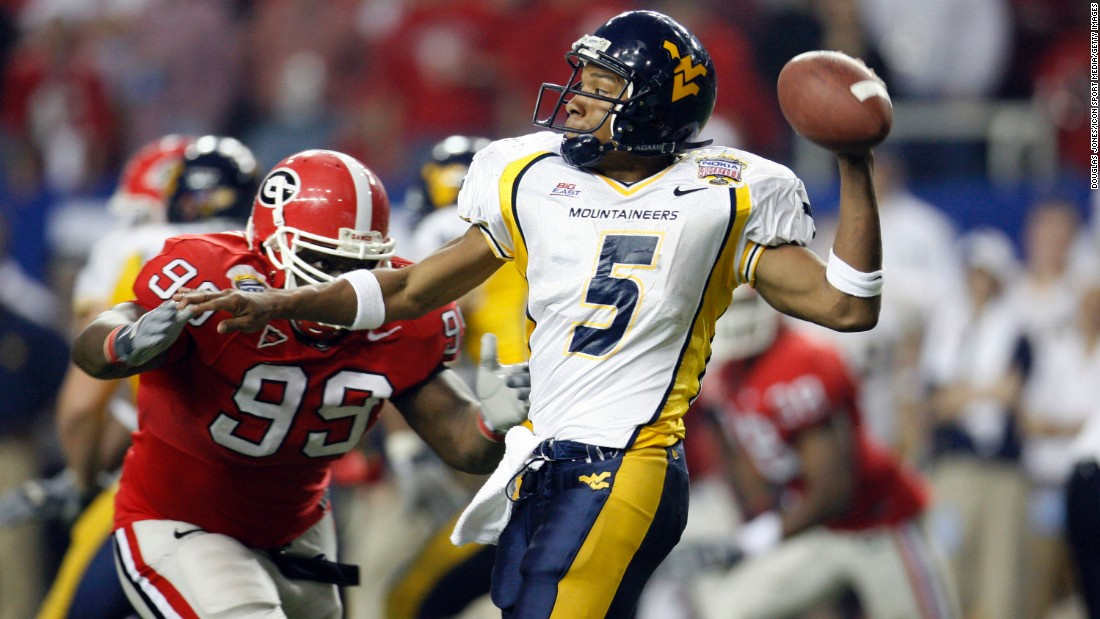 West Virginia Mountaineers quarterback Pat White throws to a receiver in the second half in a 38-35 win over the Georgia Bulldogs in the Nokia Sugar Bowl at the Georgia Dome on January 2, 2006. The game, which is held annually at the Mercedes-Benz Superdome in New Orleans, was moved to the Georgia Dome because of damage from Hurricane Katrina.