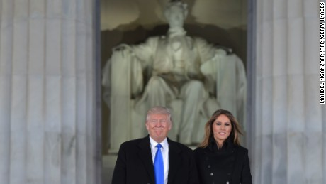 US President-elect Donald Trump and his wife Melania arrive to attend an inauguration concert at the Lincoln Memorial in Washington, DC, on January 19, 2017. / AFP / MANDEL NGAN        (Photo credit should read MANDEL NGAN/AFP/Getty Images)