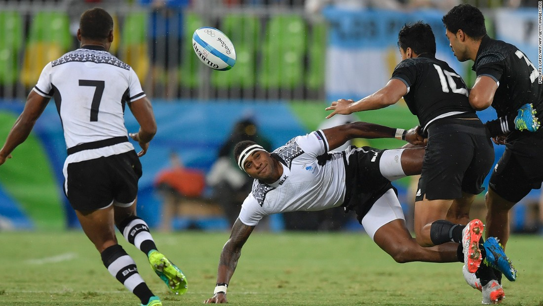 """In sevens you have to pass effectively whilst traveling at speed over greater distance than you would in 15s,"" the Welshman adds. ""You have to pass the ball backwards to move forwards, which catches a lot of people out."" Here Fiji's Semi Kunatani offloads a pass while falling against New Zealand at the Rio 2016 Olympics."