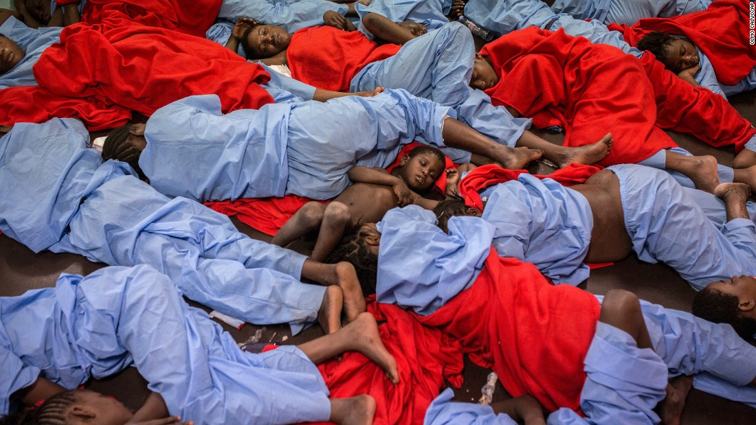 "A child from Mali, center, sleeps alongside other migrants on the deck of a vessel after being rescued from the Mediterranean Sea, about 20 miles north of Tajura, Libya, on Friday, January 13. According to the UN High Commissioner for Refugees, at least 3,800 migrants died while crossing the Mediterranean last year, <a href=""http://www.cnn.com/2016/10/26/world/mediterranean-refugees-2016-record-migrant-deaths/"" target=""_blank"">making 2016 the deadliest ever</a> for those seeking to make the journey to Europe."
