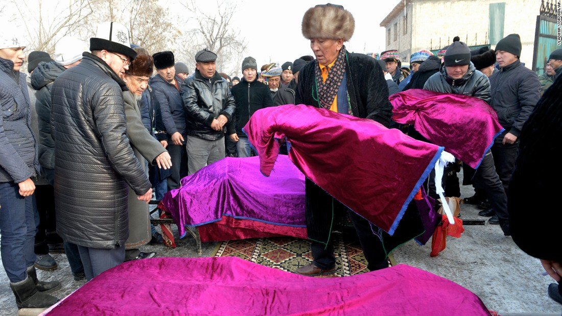"Men carry bodies during funerals for a family of four in Bishkek, Kyrgyzstan, on Tuesday, January 17. A jumbo Turkish Boeing 747 freighter crashed into the village of Dacha-Suu the day before, <a href=""http://www.cnn.com/2017/01/15/asia/kyrgyzstan-plane-crash/index.html"" target=""_blank"">killing 37 people and destroying at least 15 houses</a>, Kyrgyzstan's emergency situations ministry said. Kyrgyz Deputy Prime Minister Muhammetkaly Abulgaziev blamed the crash on ""crew error,"" but offered no details about the claim. Bad weather is also believed to be a possible cause for the crash."