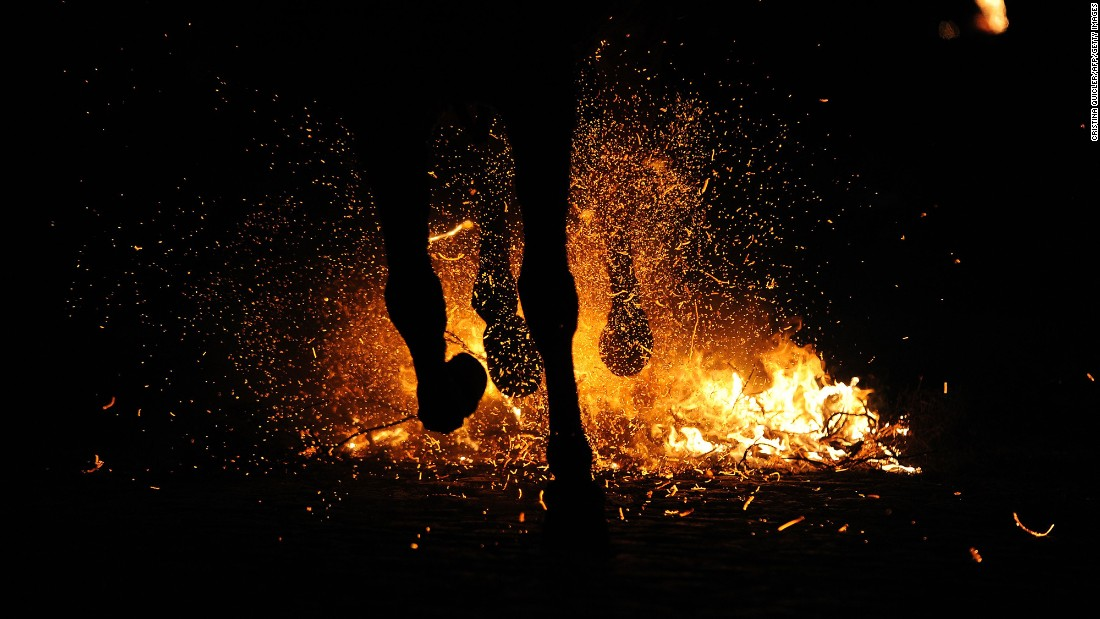 A horseman rides through a bonfire during Las Luminarias, a traditional religious festival, in Alosno, Spain, on Monday, January 16. Las Luminarias is celebrated in honor of San Antonio Abad, the patron saint of animals.
