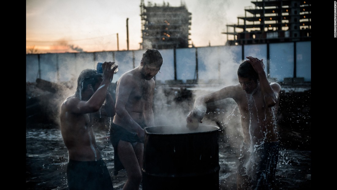 "Migrants bathe in Belgrade, Serbia, on Monday, January 16. Some 2,000 migrants have been <a href=""http://www.cnn.com/2017/01/11/europe/refugees-belgrade-europe-cold-snap/index.html"" target=""_blank"">struggling to survive the freezing Serbian winter</a>, with many facing no access to heating or warm water."
