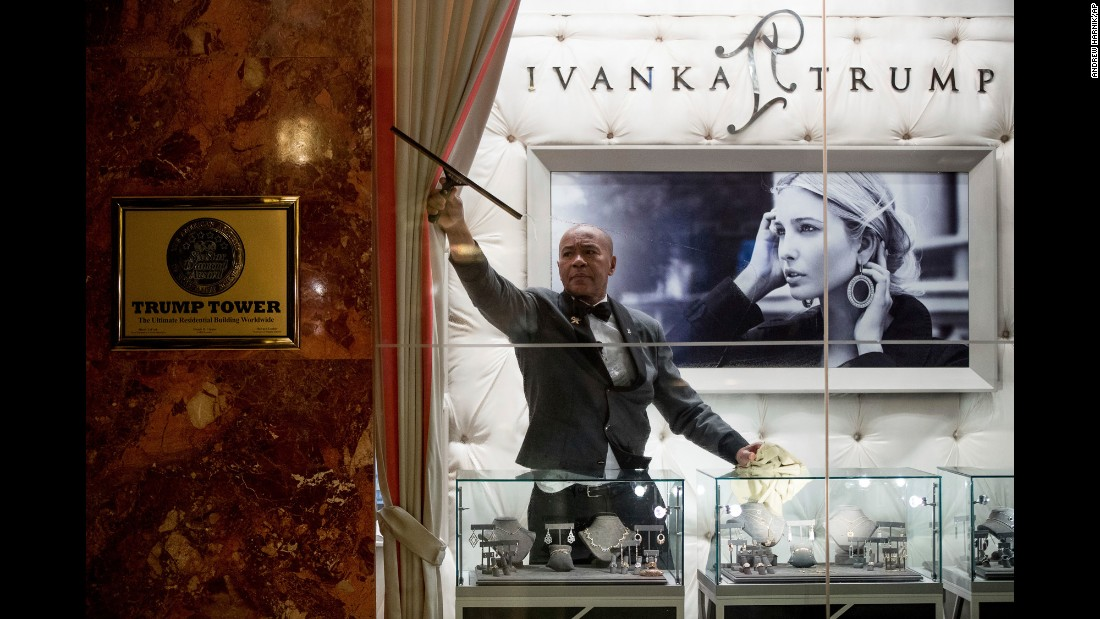 A man cleans windows in the lobby of Trump Tower in New York on Tuesday, January 17.