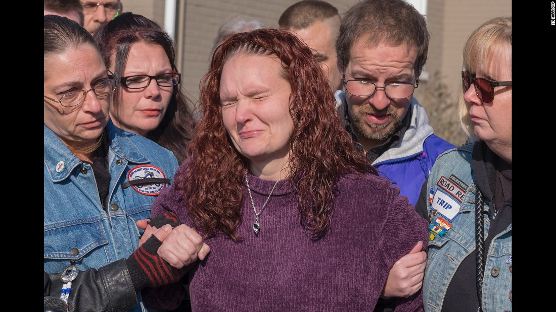 "Rose Hunsicker, center, cries as she is escorted to a public memorial service for her daughter in Glenside, Pennsylvania, on Monday, January 16. Hunsicker is the biological mother of Grace Packer, a teen who authorities say was killed and dismembered by her adoptive mother and her boyfriend. <a href=""http://www.nbcphiladelphia.com/news/local/Abington-Teen-Grace-Packer-Memorial-410817695.html"" target=""_blank"">According to NBC Philadelphia</a>, Hunsicker and her husband lost parental rights to Grace when she was 3 years old. Grace was then adopted by Sara Packer, who now faces murder charges along with her boyfriend Jacob Sullivan."
