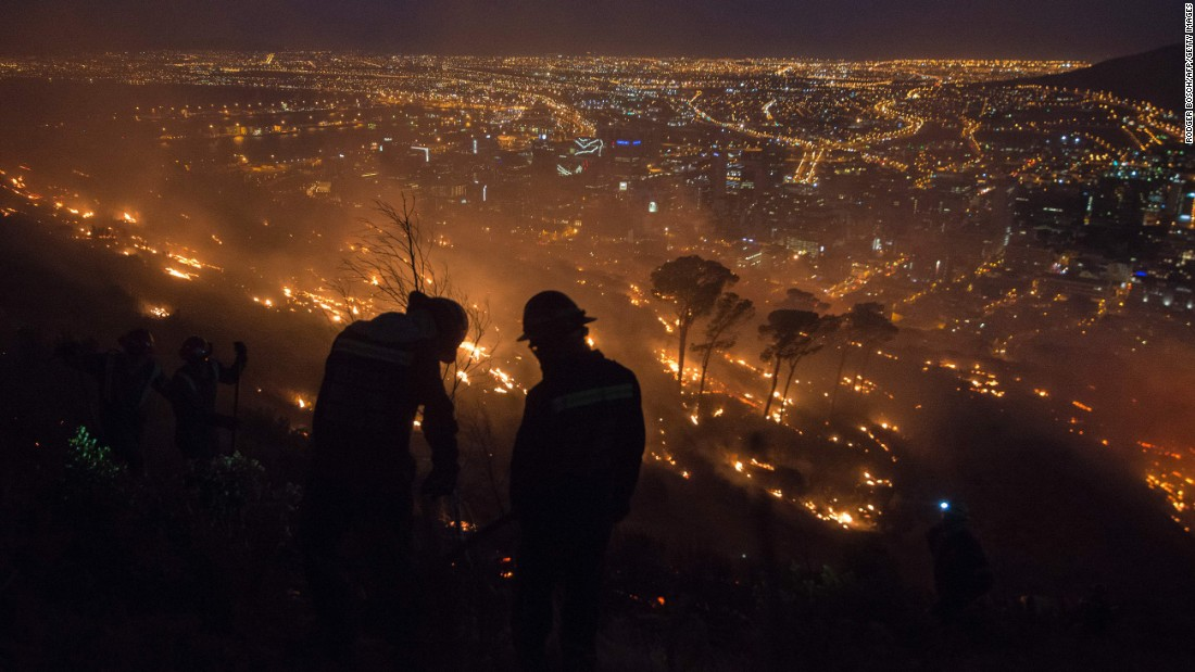 Firefighters battle a fire on Signal Hill in Cape Town, South Africa, on Friday, January 13. Wildfires have ravaged the Western Cape province for the last two weeks. Homes, farms and other structures have been burnt.