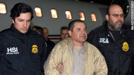 "US authorities escort Joaquin ""El Chapo"" Guzman on Thursday at a Long Island, New York, airport."