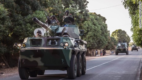 A convoy of Senegalese soldiers head toward Gambia's border Thursday.