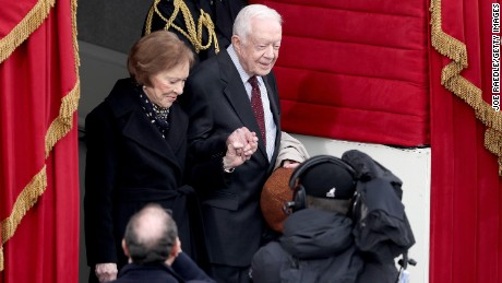 Former President Jimmy Carter and wife Rosalynn arrive for the ceremony.