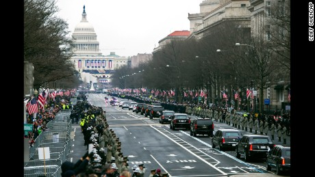 The Presidential motorcade drives down Pennsylvania Avenue to the Capitol for the inauguration ceremony.