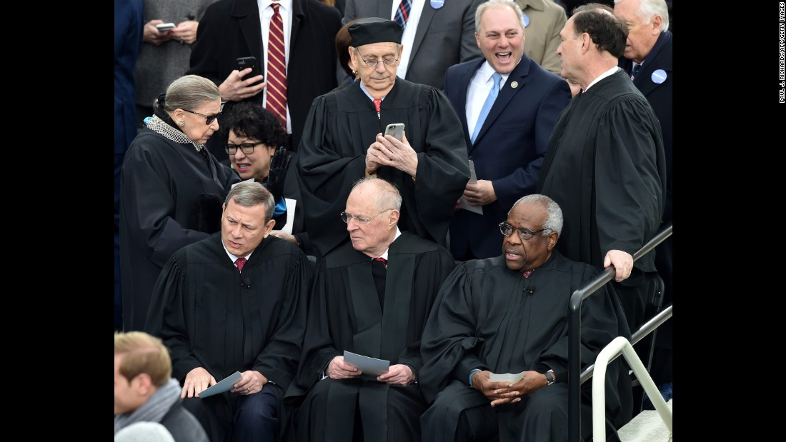 Supreme Court justices await the ceremony. Front from left: Chief Justice John Roberts and Justices Anthony Kennedy and Clarence Thomas. Back from left: Justices  Ruth Bader Ginsburg, Sonia Sotomayor, Stephen Breyer and Samuel Alito.