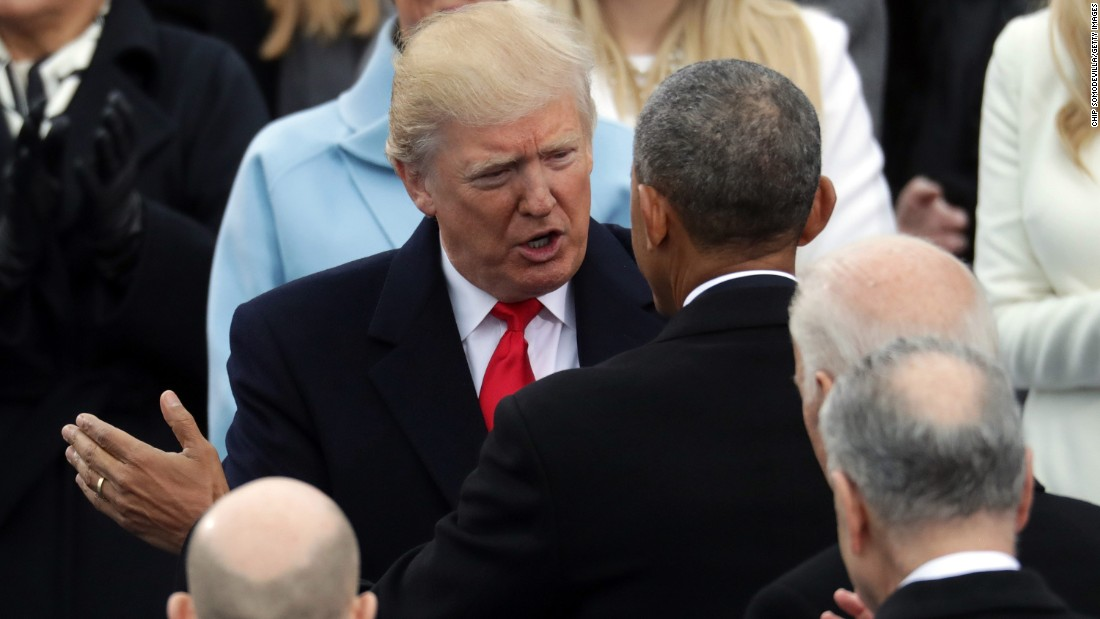 President Barack Obama chats with Trump before the ceremony.