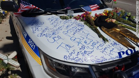 Slain Orlando police officer's car vandalized