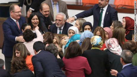 Turkish lawmakers scuffle inside Ankara's parliament on Wednesday.