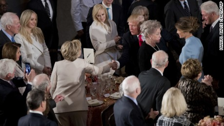 Newly sworn in President Donald Trump with his wife first lady Melania Trump, shakes hands with Hillary Clinton, as they arrive for the inaugural luncheon at the Statuary Hall in the Capitol, Friday, Jan. 20, 2017, in Washington. President Trump became the 45th president of the United States. Others are former President Bill Clinton, right, and Trump's daughter Tiffany Trump, second from left. (AP Photo/Manuel Balce Ceneta)