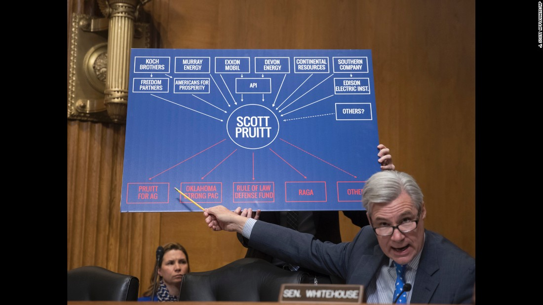 "Sen. Sheldon Whitehouse points to a chart as he questions Scott Pruitt, President Donald Trump's pick to lead the Environmental Protection Agency, during <a href=""http://www.cnn.com/2017/01/18/politics/scott-pruitt-epa-hearing/index.html"" target=""_blank"">Pruitt's confirmation hearing</a> on Wednesday, January 18. Although Pruitt broke with Trump and said he doesn't believe climate change is a hoax, he did not indicate he would take swift action to address environmental issues that may contribute to climate change."