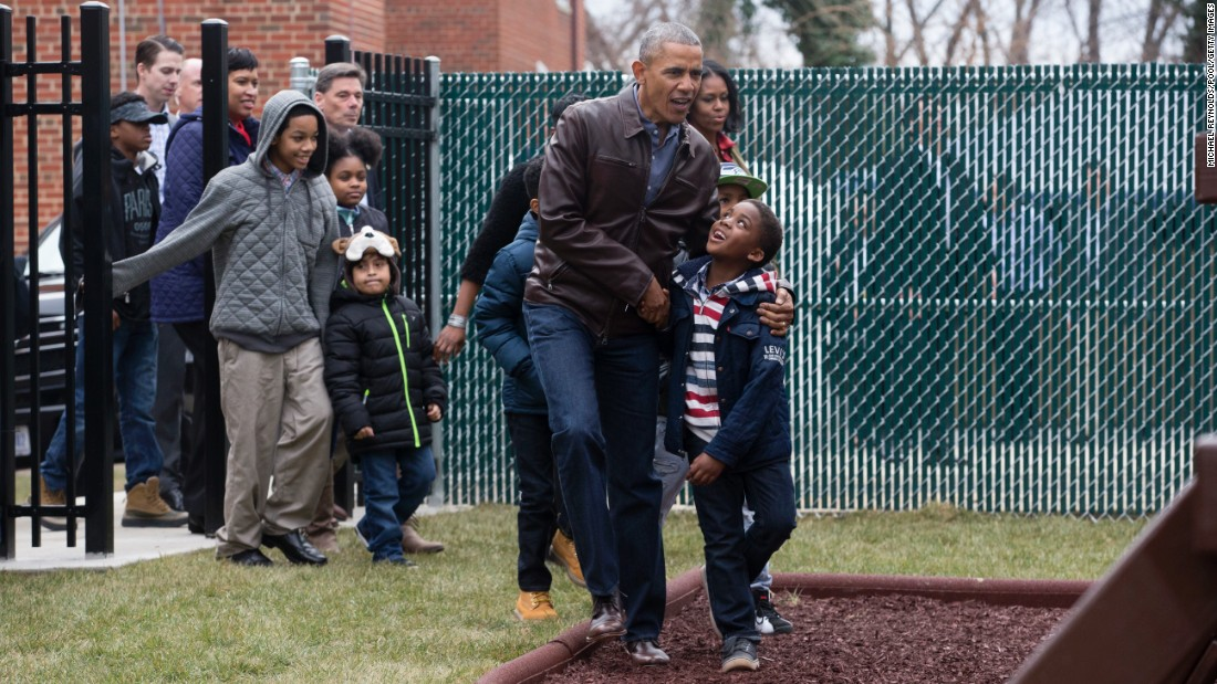 "Then-President Barack Obama and his wife, Michelle, walk with a group of children at the ""Jobs Have Priority"" Naylor Road Family Shelter in Washington on Monday, January 16 -- Martin Luther King Jr. Day. <a href=""http://www.cnn.com/2017/01/16/politics/barack-obama-michelle-obama-swing-set-washington-dc/"" target=""_blank"">The Obamas donated a swingset</a> formerly used by their two daughters, Sasha and Malia, to the DC shelter."