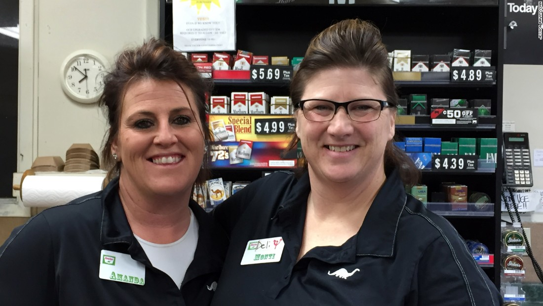 "Amanda White, 42, left, and Montica Haney, 44, work at the deli counter in the gas station. Haney's husband is employed by the railroad, so their family insurance is covered, a rarity in Grant County. White says she's on Obamacare only to avoid paying penalties. The government, she says, ""feared us into it."""