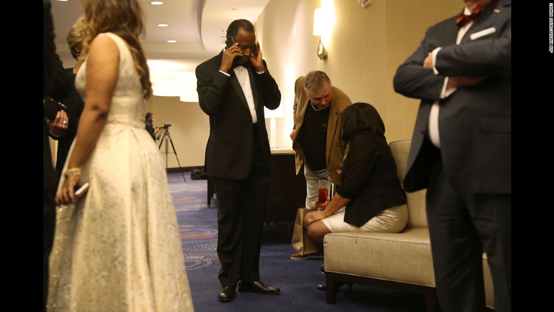 Ben Carson, President Donald Trump's pick to lead the Department of Housing and Urban Development, speaks on his cell phone during the Traditional Values Coalition's Christian Inaugural Gala in Washington on Thursday, January 19.