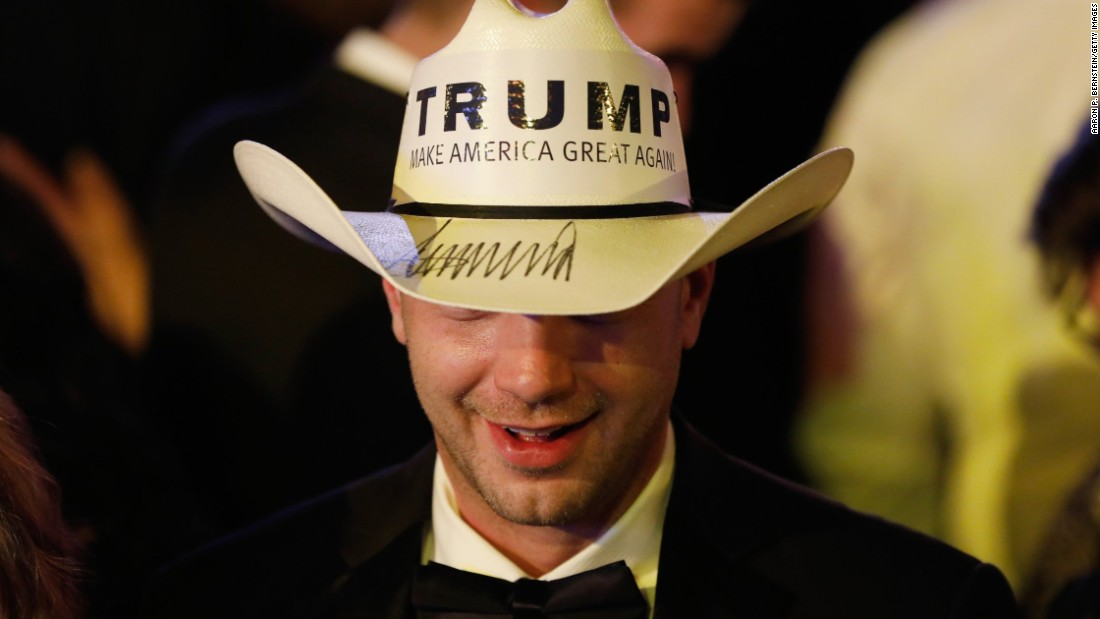 A guest wears a cowboy hat emblazoned with President Trump's campaign slogan during the Freedom Inaugural Ball.