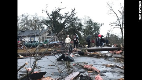 "Trees and debris cover the ground after a tornado tornado ripped through the Hattiesburg, Miss.,  area early Saturday, Jan. 21, 2017.  Mayor Johnny DuPree has signed an emergency declaration for the city, which reported ""significant injuries"" and structural damage.  (Ryan Moore/WDAM-TV via AP)"