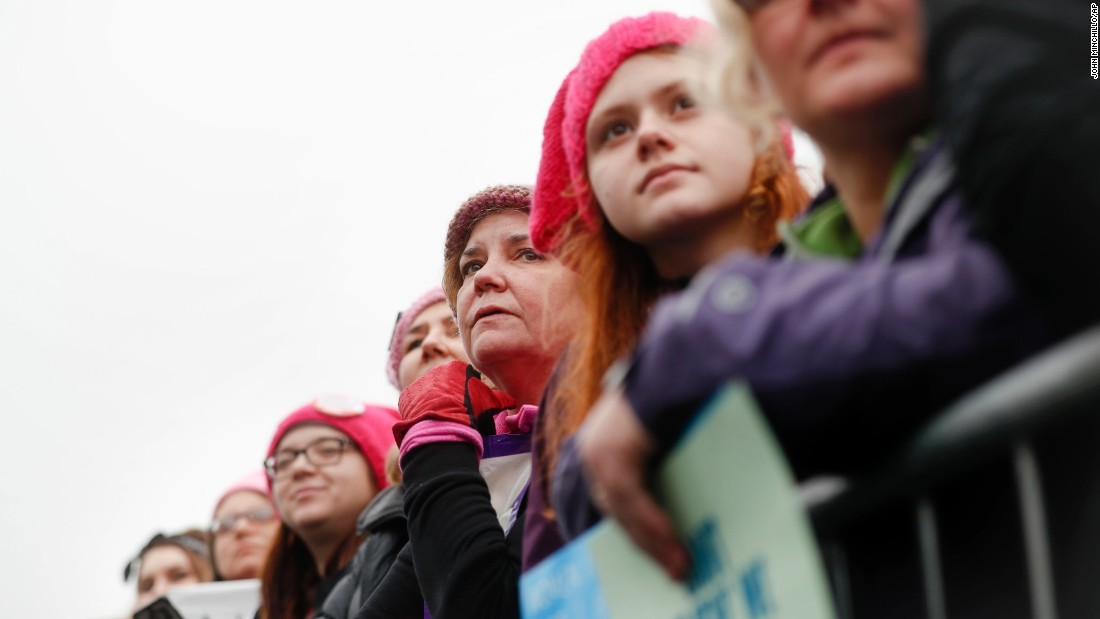 Women gather on a barricade on the National Mall.