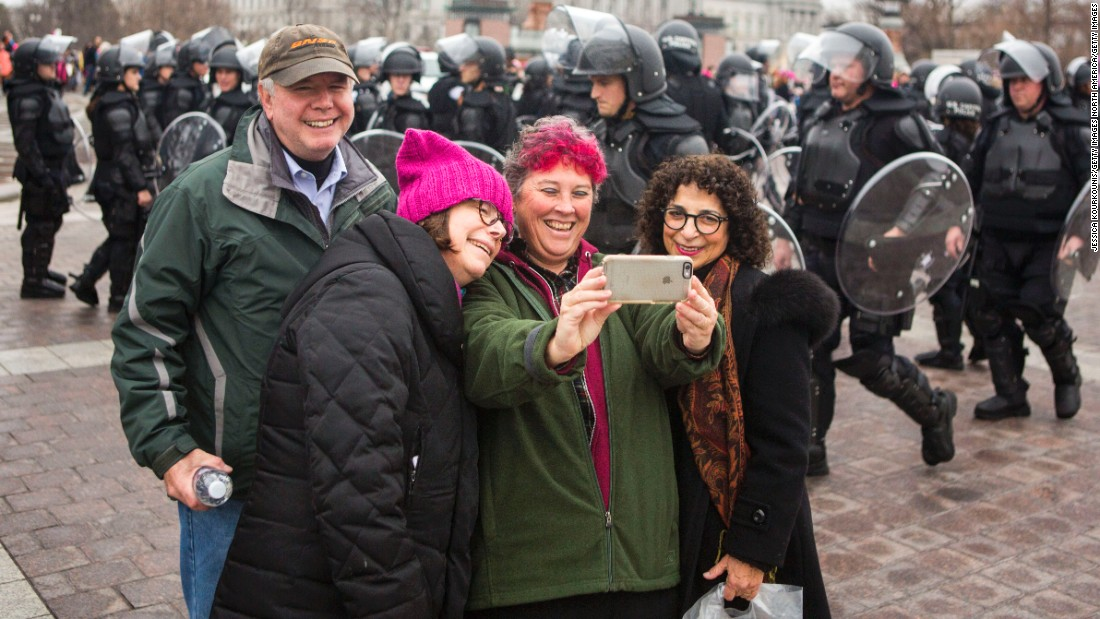 Protesters take a selfie on the grounds of the US Capitol.