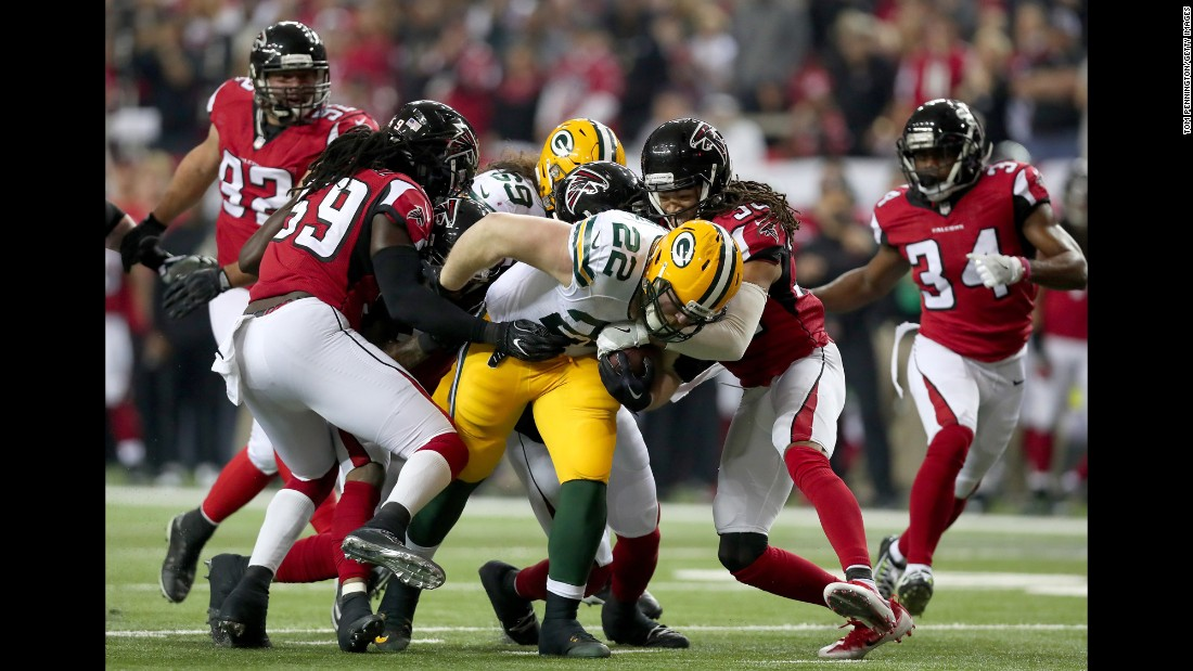 Packers fullback  Aaron Ripkowski fumbles the ball in the second quarter after contact with Falcons cornerback Jalen Collins.
