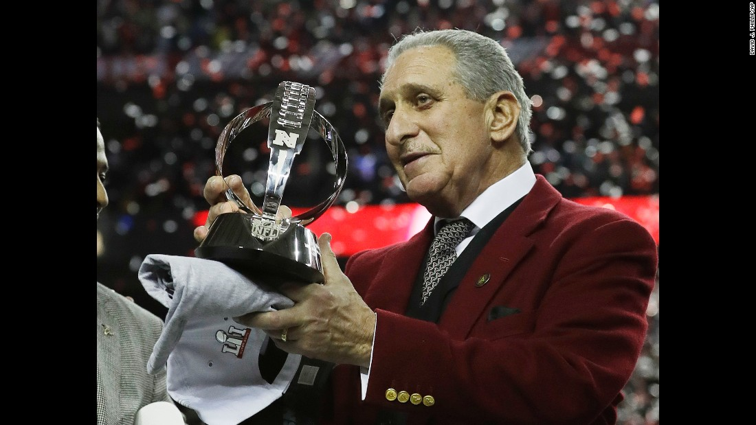 Atlanta Falcons owner Arthur Blank holds the George Halas Trophy after the NFC championship. The Falcons beat the Green Bay Packers 44-21 to advance to Super Bowl LI, where they will play the New England Patriots.