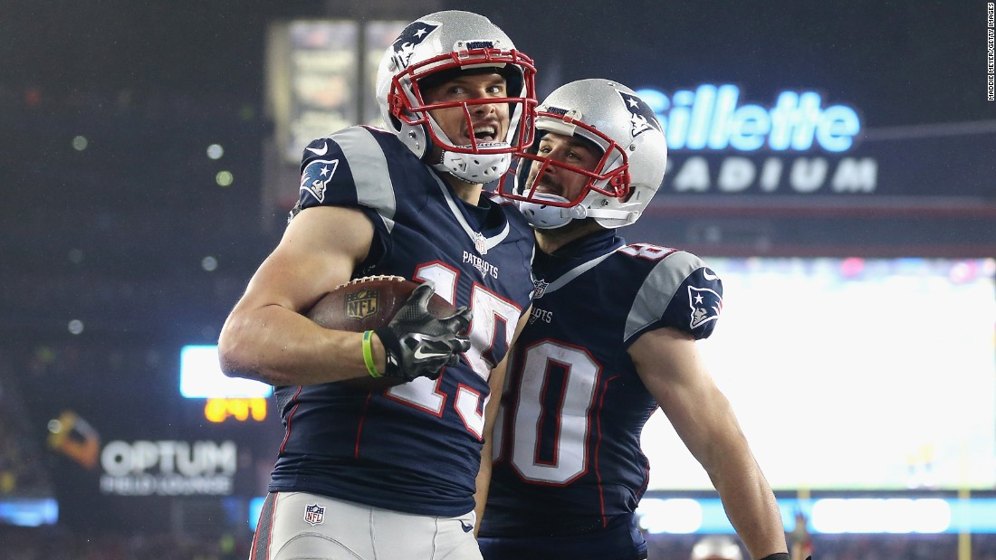 Chris Hogan, left, of the Patriots celebrates with Danny Amendola  after scoring a touchdown in the first quarter.