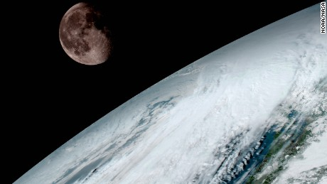 GOES-16 captured this spectacular image of the moon peeking over Earth's horizon on January 15.