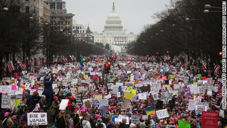 WASHINGTON, DC - JANUARY 21:  Protesters walk up Pennsylvania Avenue during the Women's March on Washington, with the U.S. Capitol in the background, on January 21, 2017 in Washington, DC. Large crowds are attending the anti-Trump rally a day after U.S. President Donald Trump was sworn in as the 45th U.S. president.  (Photo by Mario Tama/Getty Images)