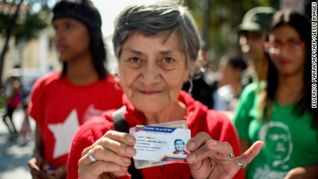 "Venezuelans line up to get the ""Fatherland's Card""  at Bolivar Square in Caracas on January 20, 2017. The Fatherland's Card will allow to buy subsidized food and to take profit of social programs. / AFP / FEDERICO PARRA        (Photo credit should read FEDERICO PARRA/AFP/Getty Images)"