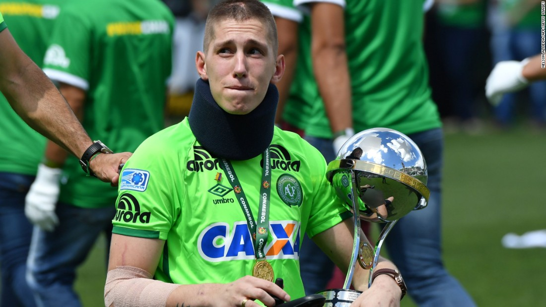 Goalkeeper Jackson Follmann holds the Copa Sudamericana trophy that was awarded to Chapecoense in the aftermath of the disaster by CONMEBOL, South American soccer's governing body. He had to have his leg amputated after surviving the crash.