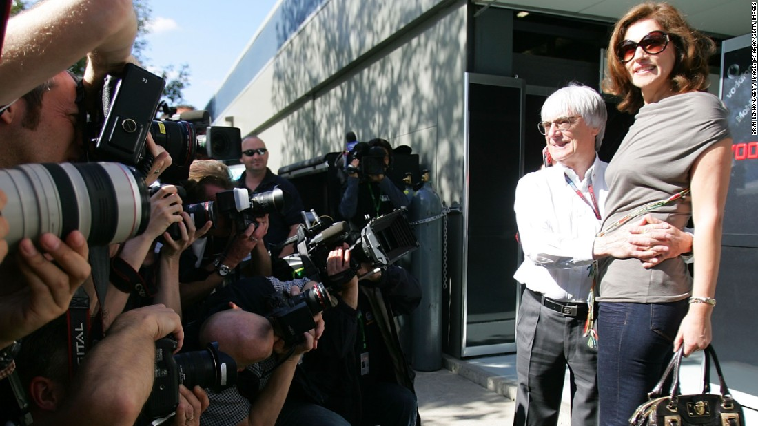 He faces the camera with her at the Australian Grand Prix in 2007.