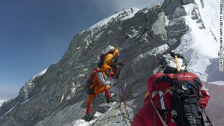 Mountaineers head for the summit of Everest. The height of the world's tallest mountain may have changed.