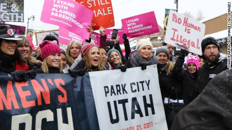 Jennifer Beals, Chelsea Handler, Mary McCormack and Charlize Theron participate in the Women's March on Main Street Park City on January 21, 2017.
