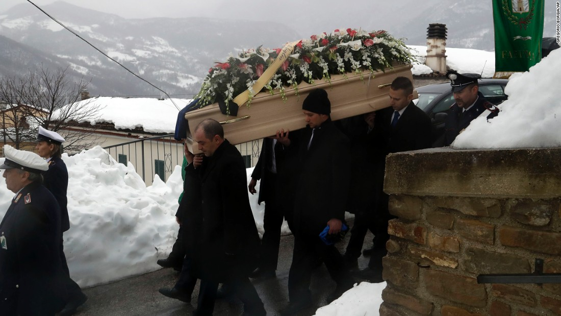 The coffin of avalanche victim Alessandro Giancaterino is carried to his funeral service in Farindola, central Italy, on Tuesday, January 24. A series of earthquakes that struck on January 18 caused an avalanche at the foot of Gran Sasso mountain in central Italy, about 135 kilometers (85 miles) northeast of Rome, burying guests and staff of Hotel Rigopiano, a local mountain resort.