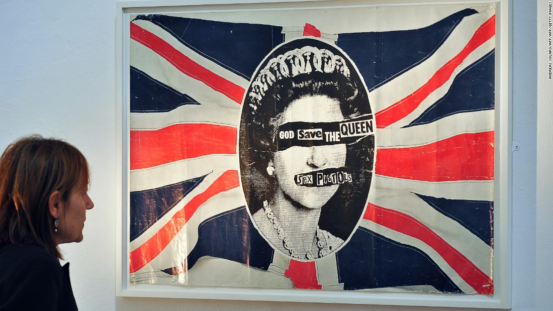 "This provocative image was originally featured on promotional posters for the British punk rock band Sex Pistols' ""God Save the Queen"" single, released to coincide with the Queen's Silver Jubilee in 1977. Like the song's lyrics, the poster, design by British artist and anarchist Jamie Reid, was controversial at the time, but has since been reproduced on everything from mugs to jackets and shirts.<br />"