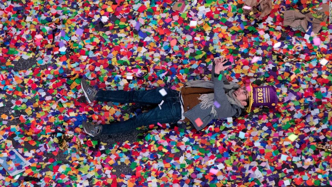 "A reveler takes a selfie in the New Year's confetti during the annual celebration in New York's Times Square. <a href=""http://www.cnn.com/2016/12/31/world/gallery/new-years-2017/index.html"" target=""_blank"">Photos: New Year's celebrations around the world</a>"