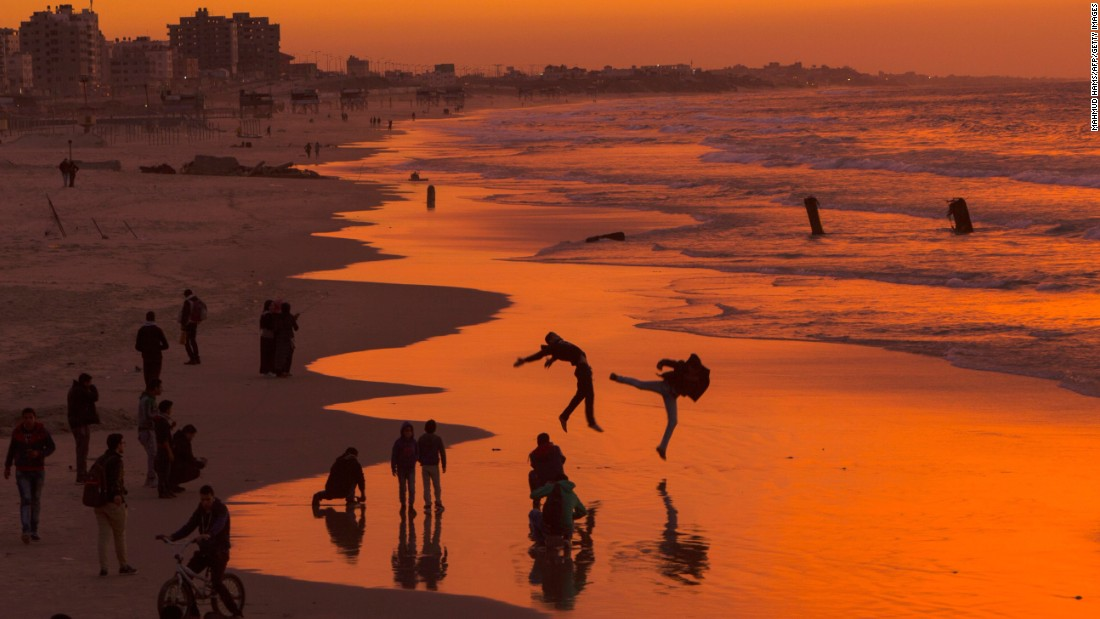 <strong>Gaza City:</strong> Palestinians enjoy the sunset on one of the city's beaches. Gaza City is home to about half a million people.