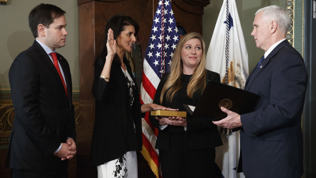 South Carolina Gov. Nikki Haley takes the oath of office as she becomes the US Ambassador to the United Nations on Wednesday, January 25. She is joined by US Sen. Marco Rubio and staffer Rebecca Schimsa as she is sworn in by the vice president.