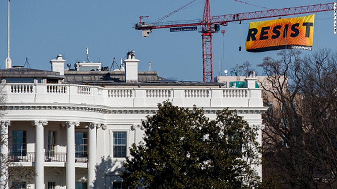 Activists protest Trump by climbing crane near White House