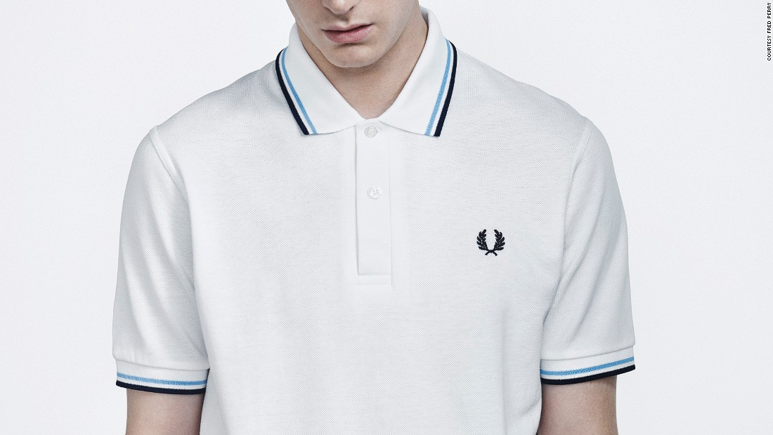 Launched at the Wimbledon tennis championship in 1952 and produced only in white for the first few years, designer and tennis champion Fred Perry's original M12 Fred Perry shirt, with the iconic sewn-in logo, was the first sports shirt with a tipped collar. Later favored by everyone from football fans in the 50s to mods and skinheads in the 60s and 70s, the now-classic design was among the first to make the crossover from sportswear to streetwear.<br />